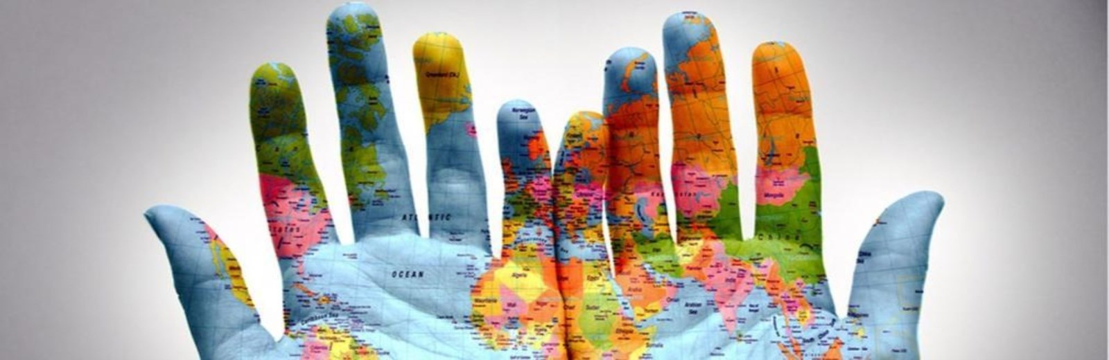 hands with world map painted on them